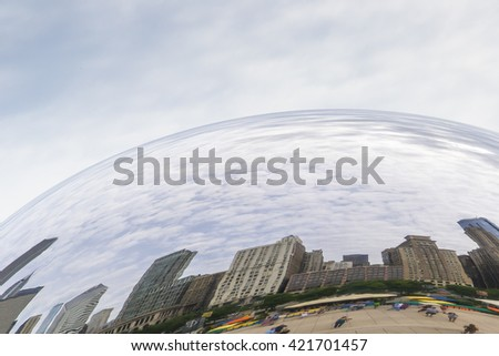 "CHICAGO,USA-AUGUST 12,2013:view of the skyline of Chicago from millenium park reflected in  the famous monument ""clouds gate"" - stock photo"