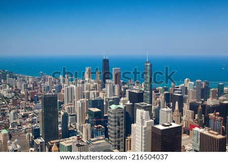 CHICAGO,USA-JULY 11,2013: Chicago skyline panorama aerial view with skyscrapers over Michigan Lake - stock photo