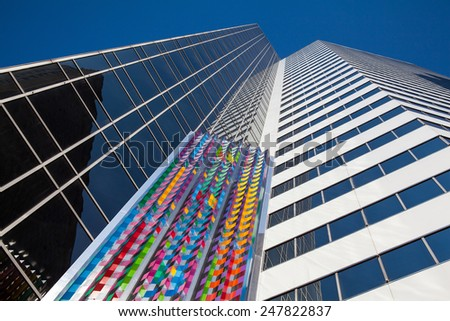Chicago,USA-June 11,2013:Art sculpture on the wall of a skyscraper in Chicago, USA - stock photo