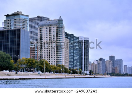 CHICAGO, USA - OCTOBER 5: Chicago city buildings beside Michigan Lake, in downtown of Chicago, Illinois, in October 5th, 2014.Chicago is the biggest city in North of USA. - stock photo