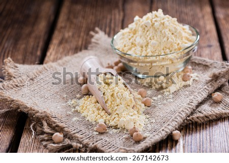 Chick Pea flour (close-up shot) on vintage wooden background - stock photo