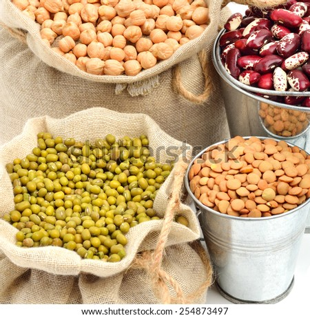 chick-pea, mung beans, kidney-beans in the sacks isolated on white - stock photo