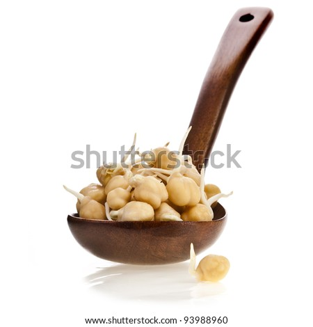 Chick peas over wooden spoon isolated on white - stock photo
