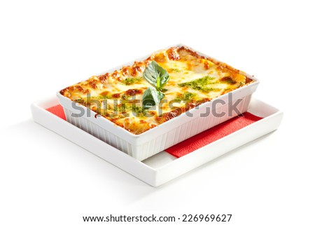 Chicken and Lettuce under Baked Cheese with Pesto - stock photo