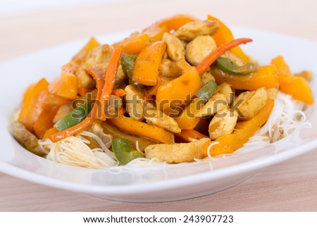chicken and mango curry on rice noodle - stock photo