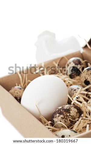 Chicken and quail eggs in box - stock photo