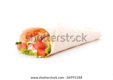 chicken and vegetables wrapped in a tortilla - stock photo