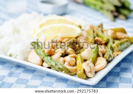 chicken asparagus lemon stir fry. the toning. selective focus - stock photo
