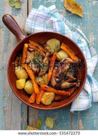 Chicken baked with potatoes and pumpkin - stock photo