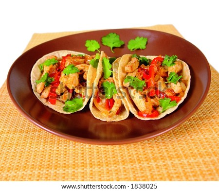 Chicken, beef and vegetable fajitas in tortillas Mexican style - stock photo