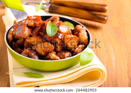 Chicken breast bits in soy sauce casserole - stock photo