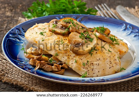 Chicken breast grilled with mushrooms - stock photo