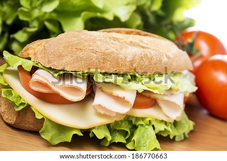 chicken breast sandwich with salad, cheese and tomatoes - stock photo