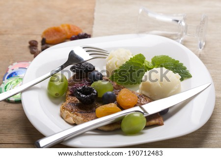 chicken breast with dried fruit decorated on the plate - stock photo