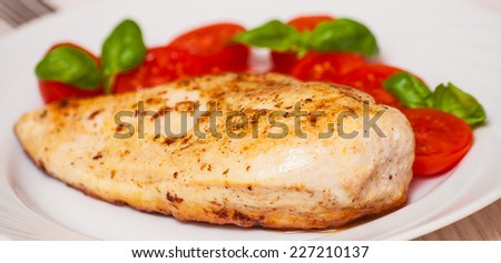 chicken breast with fresh cherry tomatoes - stock photo