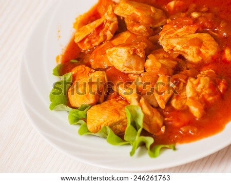 chicken breast with fresh tomato sauce - stock photo