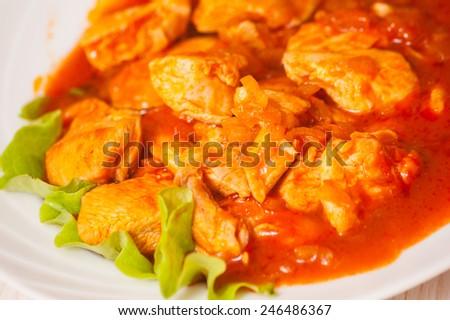 chicken breast with fresh tomato sauce - stock photo