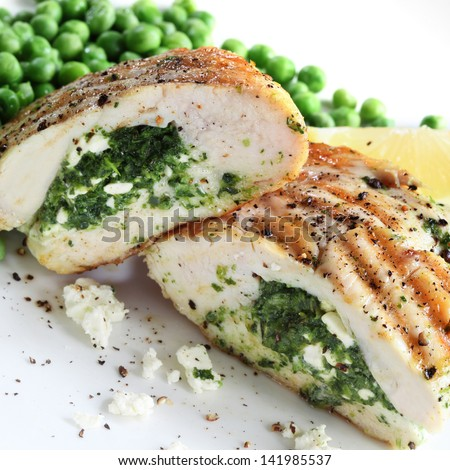 Chicken breasts stuffed with spinach and ricotta cheese. - stock photo