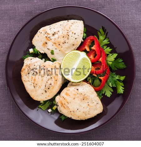 Chicken breasts with parsley and citrus top view. Healthy food. - stock photo
