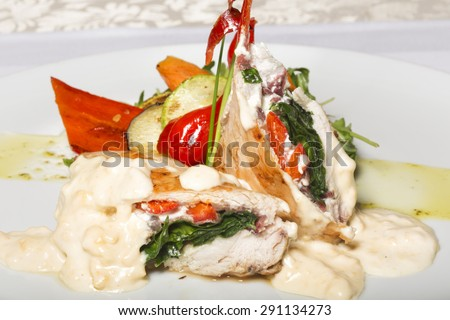 Chicken breasts with vegetable and bechamel sauce - stock photo