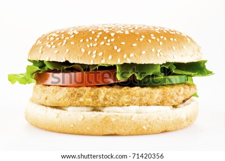 Chicken burger with tomato cucumber lettuce and mayonnaise over white - stock photo