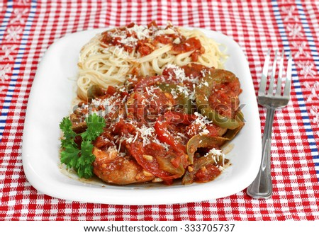 Chicken cacciatore stew  with a side of pasta. - stock photo