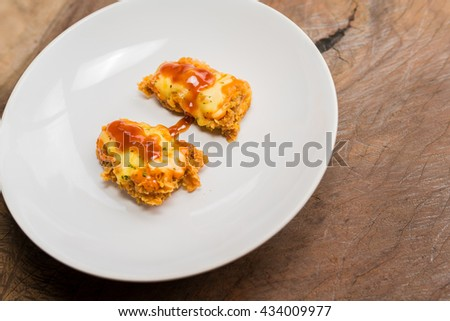chicken cheese nuggets in white dish on wooden board, top view - homemade chicken nuggets - stock photo