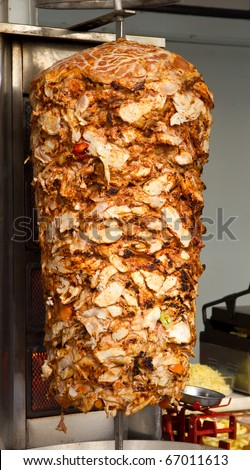 Chicken Cooking on Rotating Vertical Spit for Turkish Doner Kebab - stock photo
