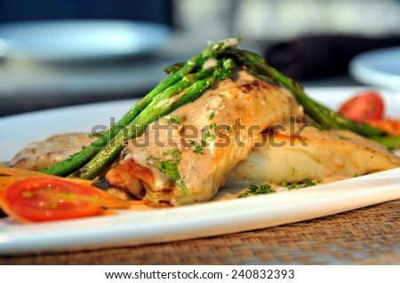 Chicken Crepes with mushroom sauce. - stock photo