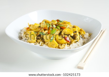 Chicken curry in a white bowl with chopsticks - stock photo