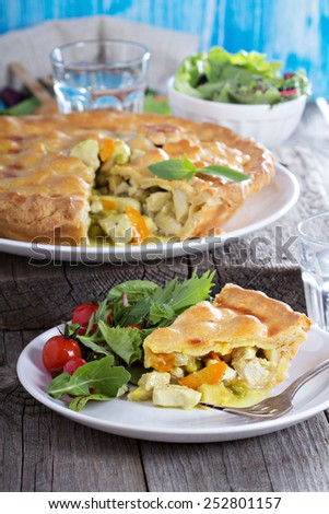 Chicken curry savory pie with carrot and green peas - stock photo