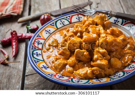 Chicken curry tikka masala with basmati rice on decorated bowl - stock photo