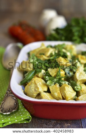 Chicken curry with asparagus bean on a rustic background. - stock photo