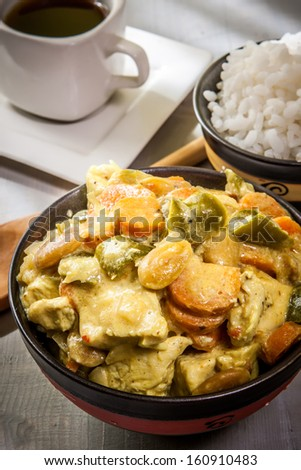 chicken curry with boiled basmaty rice on bowl - stock photo