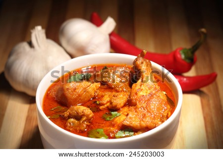 Chicken curry with onions and chili - stock photo