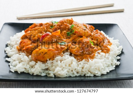 Chicken curry with rice and chopsticks - stock photo