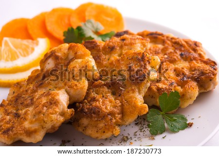 Chicken cutlets in plate, selective focus - stock photo