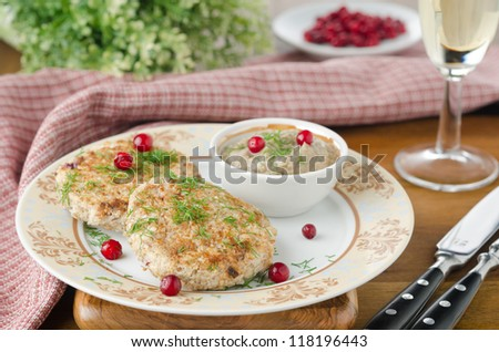 Chicken cutlets with cowberry and mushroom sauce - stock photo