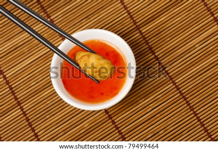 Chicken deep fried in batter with a Sweet and Sour dipping sauce - stock photo