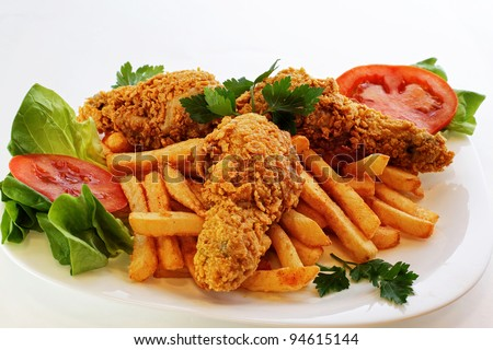 chicken drumstick on french fried - stock photo