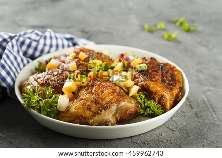 Chicken drumstick with fruit salsa - stock photo