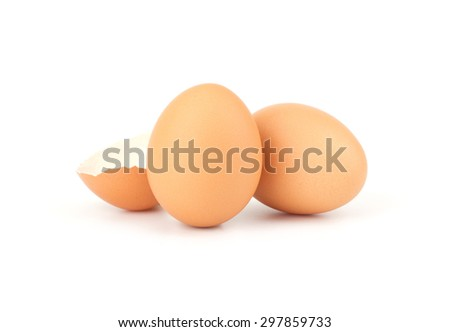Chicken eggs and egg shell closeup isolated on white background - stock photo