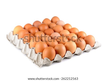 Chicken eggs in egg tray on white - stock photo