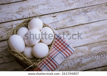 Chicken eggs in the basket - stock photo