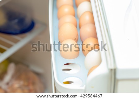 Chicken eggs in the fridge - stock photo