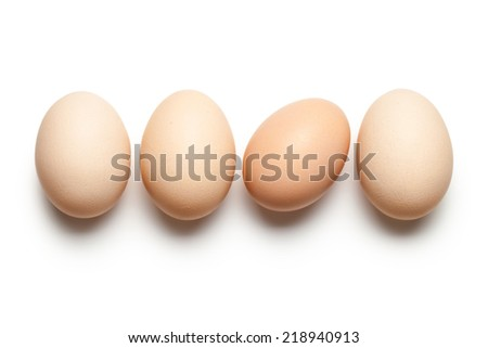 Chicken eggs on white background. Top view - stock photo