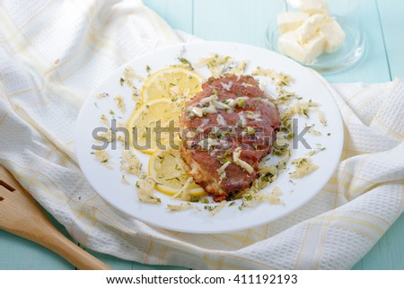 Chicken fillet in breadcrumbs with lemon and cheese. - stock photo