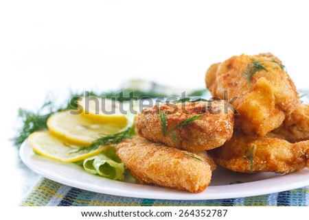 chicken fried in batter with dill on a white background - stock photo