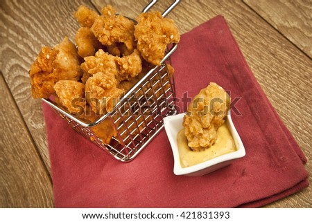 Chicken fry pop with honey mustard on the wooden table - stock photo