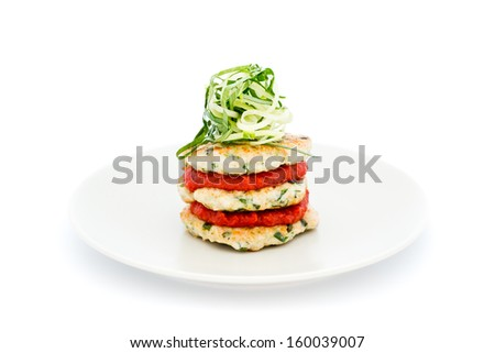 Chicken griddle-cake with Thai herbs, tomato chilli jam and cucumber noodles isolated on white background - stock photo